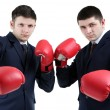 Two handsome businessmen with boxing gloves isolated on white — Stock Photo #67204673
