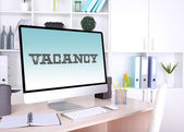 Office workplace with vacancy sign — Stock Photo