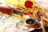Marine still life with world map and rope on wooden table background — Stock Photo