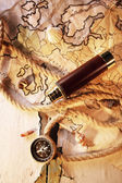 Marine still life spyglass and world map on old wooden background — Stock Photo