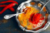 Carry and paprika with chili pepper on silver tray and color rustic wooden table background — Stock Photo