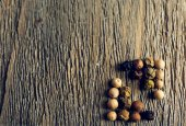 Allspice pepper on rustic wooden table background — Stock Photo
