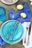 Easter table setting on color wooden background — Stock Photo