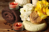 Composition of spa treatment, candle and flowers  on wooden table background — Stock Photo