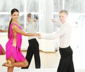 Beautiful couple in active ballroom dance, indoors — Stock Photo