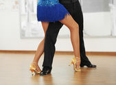 Beautiful womanish and masculine legs in active ballroom dance, indoors — Stock Photo