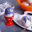 Painting Easter eggs on colorful tablecloth background — Stock Photo #67277819