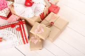 Beautiful gift boxes on wooden background. Valentine Day concept — Стоковое фото