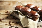 Tasty homemade chocolate muffins on wooden table — Stock Photo