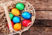 Easter eggs in basket on vintage wooden planks background — Stock Photo