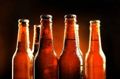 Glass bottle of beer on dark background — Стоковое фото