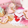 Heart shaped cookies for valentines day on plate, tea bags and card on color wooden background — Stock Photo #67452225