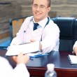 Attractive male doctor in conference room — Stock Photo #67452631