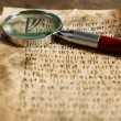 Grunge papers with hieroglyphics with magnifier close up — Stock Photo #67453917