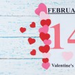 Valentines Day, February 14 on calendar on wooden background — Stock Photo #67458199