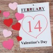 Valentines Day, February 14 on calendar on wooden background — Stock Photo #67458205
