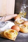 Still life of preparing pasta on rustic wooden background — Stock Photo