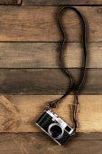 Retro camera on wooden planks background — Stock Photo
