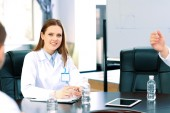 Beautiful young doctor in conference room — Stock Photo