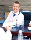 Attractive male doctor in conference room — Stock Photo