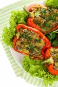Stuffed red peppers on plate on napkin close up — Stock Photo