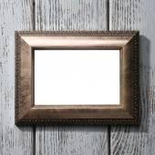 Vintage photo frame on color wooden background — Stock Photo