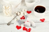 Heart shaped teabag tags, box and teapot on wooden background — 图库照片