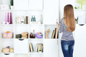 Woman looking for something in closet, in room with modern interior — Stock Photo