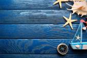 Beautiful sea composition with boat and shells on wooden background — Zdjęcie stockowe