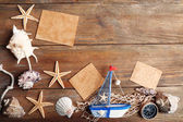 Beautiful sea composition with boat and shells on wooden background — Stock Photo