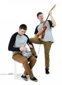 Two handsome young men with musical instruments isolated on white — Stock Photo