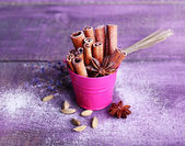 Spices with lavender and powdered sugar on color wooden table background — Stock Photo