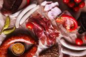 Assortment of deli meats on parchment background — Stock Photo