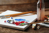 Professional art materials on wooden background — Stock Photo