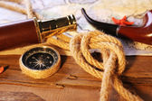 Marine still life with world map and rope on wooden table background — Stockfoto