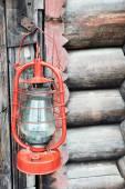 Kerosene lamp on wooden door background — Stock Photo