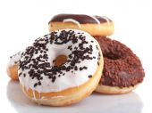 Delicious donuts with icing isolated on white — Foto de Stock