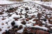 Many stones covered with snow — Stock Photo