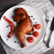Smoked chicken leg  with vegetables on plate on table close up — Stock Photo #68115331
