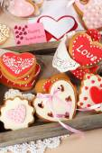 Heart shaped cookies for valentines day on tray, on color wooden background — Stock Photo