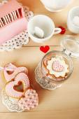 Heart shaped cookies for valentines day and tea bags on wooden background — Stock Photo