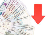 Red arrow on Russian money as depreciation of currency isolated on white — Stock Photo