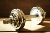 Big dumbbells on wooden background — Stock Photo