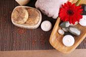 Composition of spa stones, sea salt and massage bags on wooden table, on light color background — Stock Photo