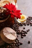 Composition of spa treatment, flowers and coffee beans on wooden background — Stock Photo