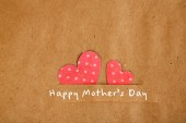 Paper hearts on brown background, close up — Foto de Stock