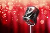 Retro microphone on bright curtain background — Stock Photo