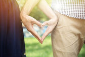 Loving couple holding hands outdoors — Stock Photo