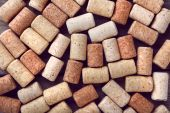 Wine corks on rustic wooden table background — Stock Photo