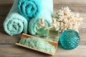 Spa composition with towels and sea salt on on wooden table — Stock Photo
